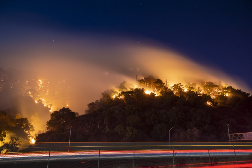 Traffic moved slowly Friday as the Saddleridge fire flared up in the hills along the 5 Freeway in the Newhall Pass.