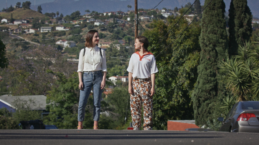 Two women stand on an L.A. street.