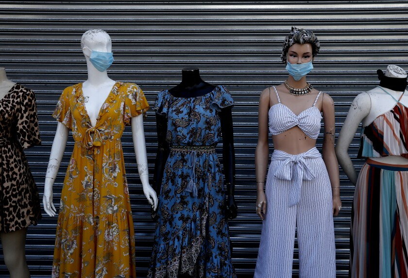Mannequins wear protective masks in the garment district in downtown Los Angeles.