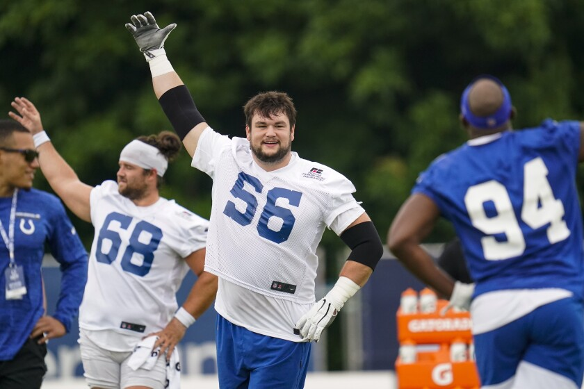 Indianapolis Colts guard Quenton Nelson warms up during practice at the NFL team's football training camp in Westfield, Ind., Thursday, July 29, 2021. (AP Photo/Michael Conroy)