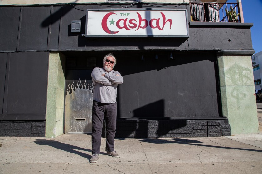File photo of the Casbah owner Tim Mays posing outside of the live music venue and bar in midtown, which is temporarily shut down.