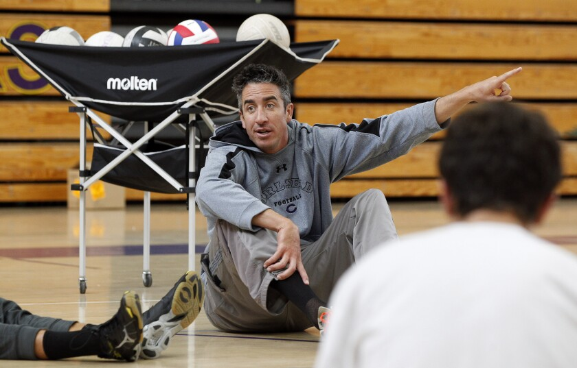 Carlsbad volleyball coach Andy Tomkinson (shown at an earlier practice) has guided the Lancers to a 15-10 record this season.