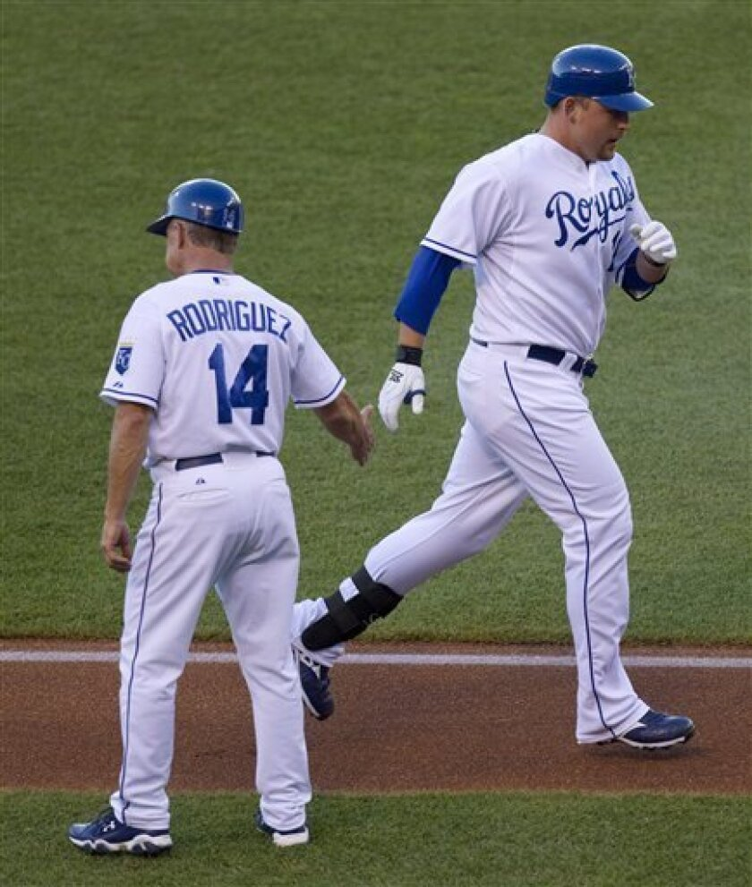 Kansas City Royals first baseman Billy Butler celebrates with third base coach Eddie Rodriguez (14) after hitting a home run during the first inning of a baseball game against the Chicago White Sox Wednesday, June 30, 2010 in Kansas City, Mo. (AP Photo/Charlie Riedel)