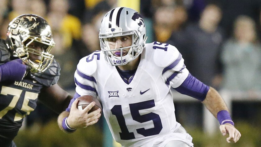 Kansas State quarterback Jake Waters scrambles with the ball during a loss to Baylor on Dec. 6.