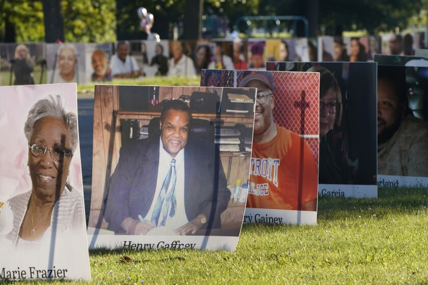 Some of the nearly 900 poster-sized photos of Detroit victims of COVID-19 are displayed Aug. 31 on Belle Isle in Detroit.