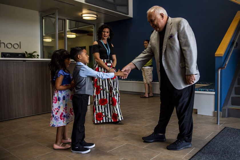 Padres Executive Chairman Ron Fowler meets several students at the Monarch School in San Diego, California on Thursday, May 2, 2019.