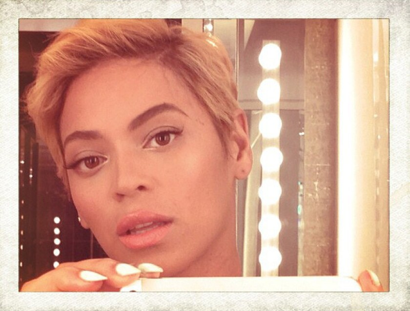 Beyonce debuts her pixie hair cut on Instagram.