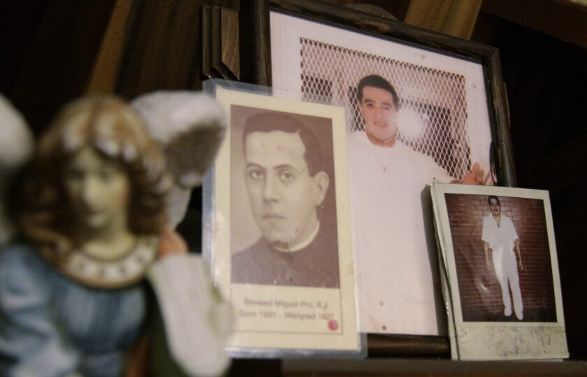 Images of Mexican inmate Edgar Tamayo are among other items on an altar in Cuernavaca, Morelos, Mexico.