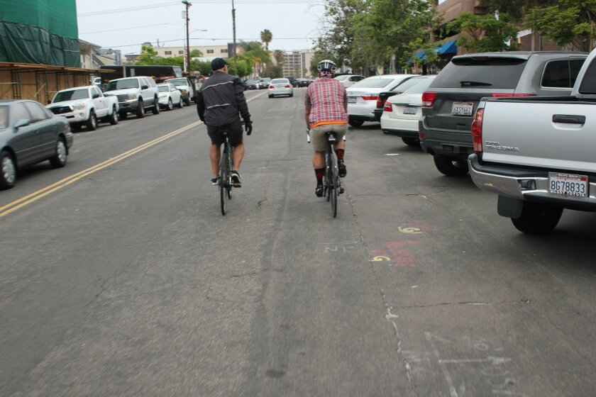 Biking enthusiasts (and brothers) John and Andy Hanshaw cycle through the Village of La Jolla May 19 to rate its bike-friendliness.