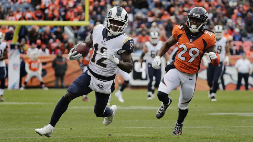 Rams wide receiver Brandin Cooks (12) outruns Denver Broncos cornerback Bradley Roby (29) for extra yardage in the first half in Week 6.