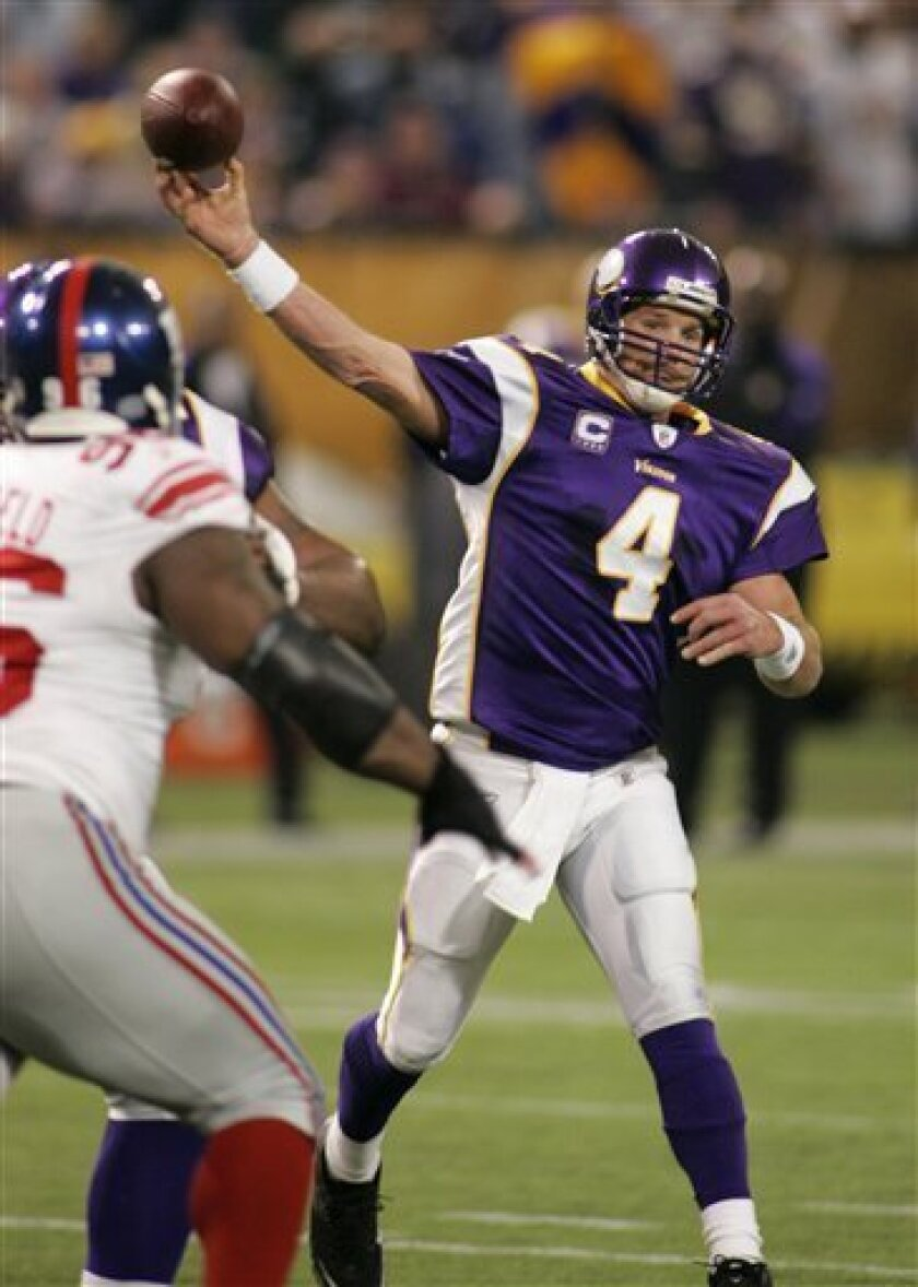 Minnesota Vikings quarterback Brett Favre (4) throws in the second quarter against the New York Giants during an NFL football game in Minneapolis, Sunday, Jan. 3, 2010. (AP Photo/Andy King)