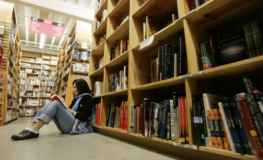 A woman reads a book in Powell's Bookstore in downtown Portland, Oregon in this file photo.