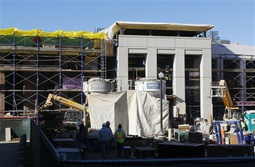 In this Dec. 21, 2012, photo, construction continues on the new strength training center as part of the Alabama athletic facilities in Tuscaloosa, Ala. (AP Photo/Butch Dill)