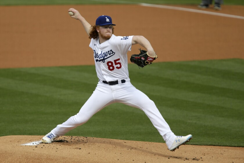 Dodgers pitcher Dustin May throws against the San Diego Padres on April 25.