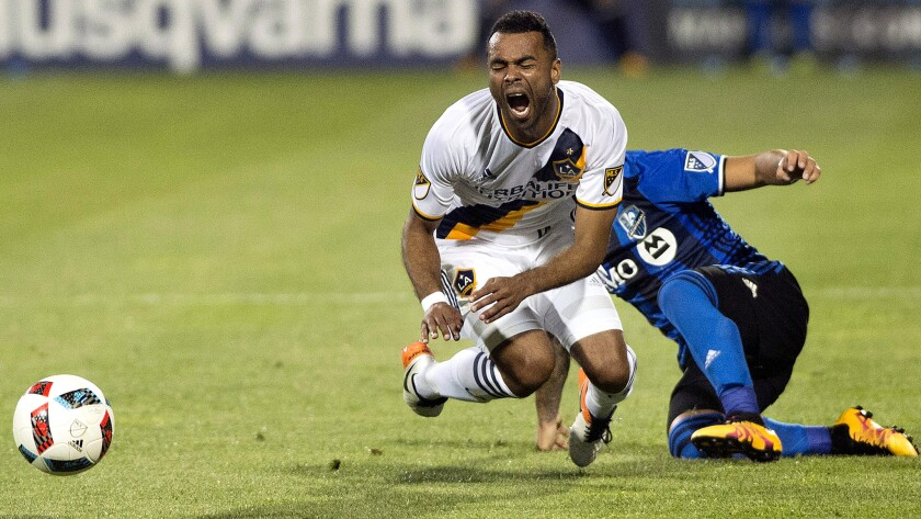 Galaxy defender Ashley Cole is tackled by Montreal's Lucas Ontivero during the second half Saturday.