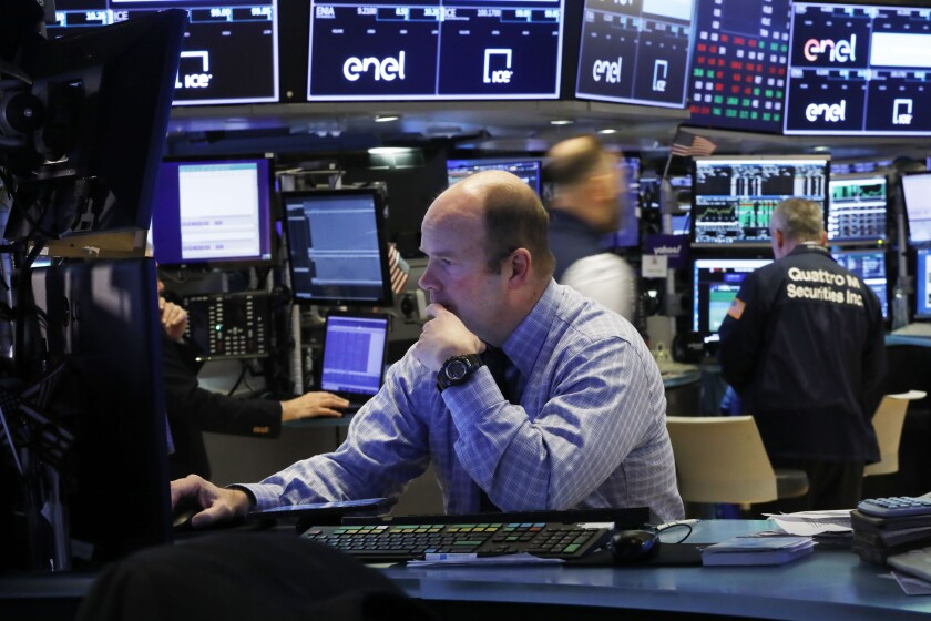 Trader Peter Mancuso, shown on the floor of the New York Stock Exchange on March 5, prepares for the day's trading.