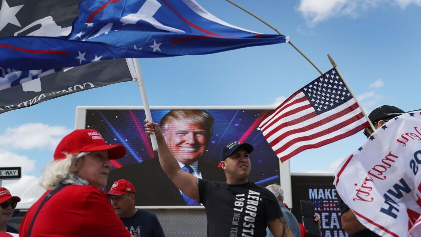 WEST PALM BEACH, FL - MARCH 04: Richard Montero (C) shows his support for President Donald Trump ne
