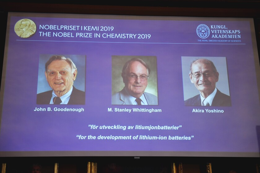 Images of John B. Goodenough, M. Stanley Whittingham and Akira Yoshino, winners of the 2019 Nobel Prize in chemistry, are projected on a screen in Stockholm.