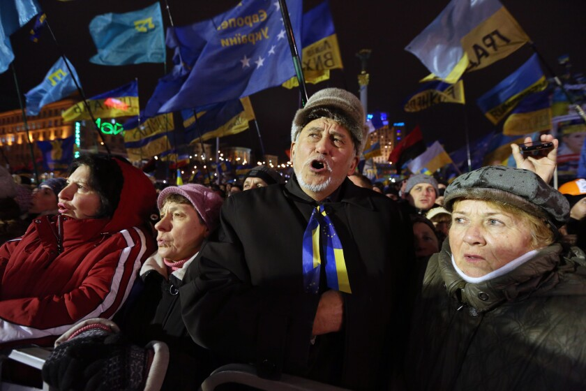 Thousands of protesters in Kiev's Independence Square on Tuesday demanded President Viktor Yanukovich's resignation upon hearing news of an agreement with Russia.