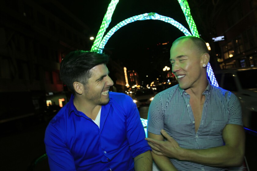 Cristian and Richard finished the night with a pedi-cab ride to Florent where they sat tandem on a swing in a birdcage. (David Brooks)