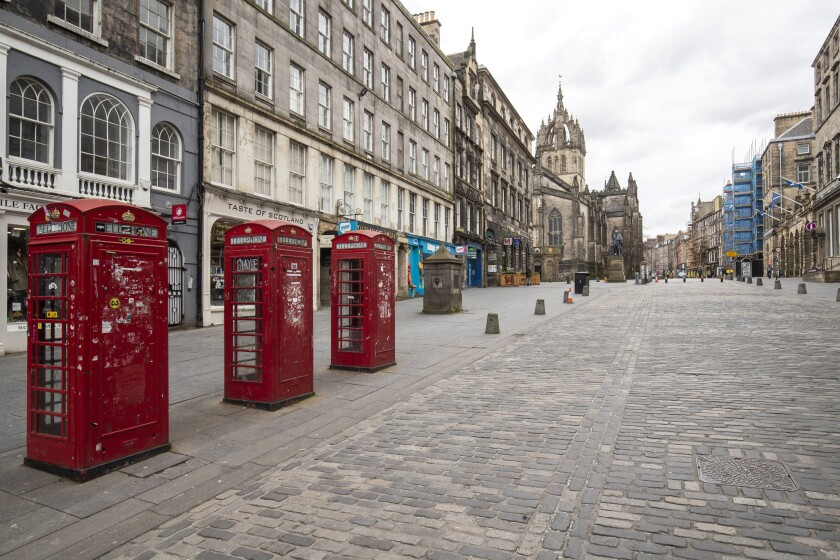 The Royal Mile in Edinburgh, Scotland, was deserted Saturday, the day after Boris Johnson ordered pubs and restaurants across the U.K. to close.
