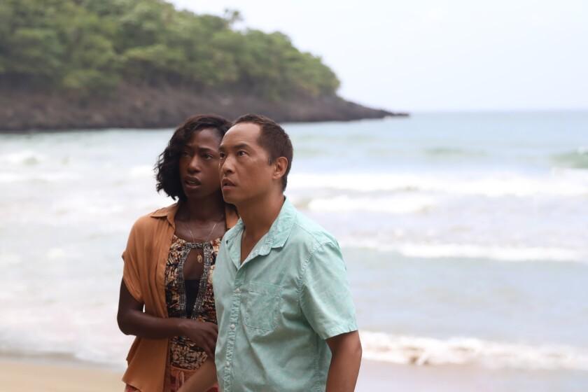 Nikki Amuka-Bird and Ken Leung in the movie