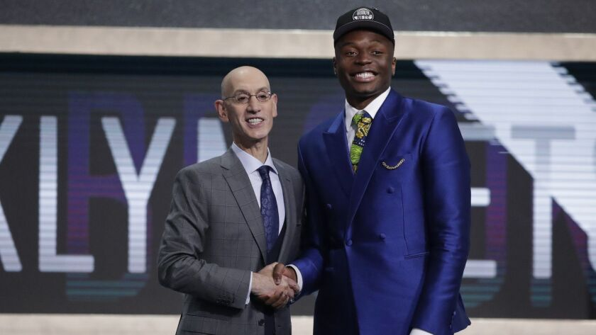NBA Commissioner Adam Silver poses for photographs with Florida State's Mfiondu Kabengele after the