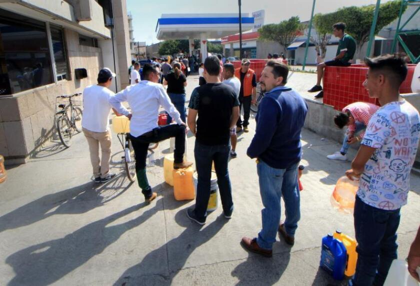People queue to buy rationed gasoline in Leon, Mexico, on 7 January 2019, due the distribution problems in several states. Mexican President Andres Manuel Lopez Obrador announced that the Army has reinforced surveillance at facilities of Petroleos Mexicanos (Pemex) since Monday, after days of gasoline shortages due to supply problems in several states. EPA-EFE/ Mario Armas