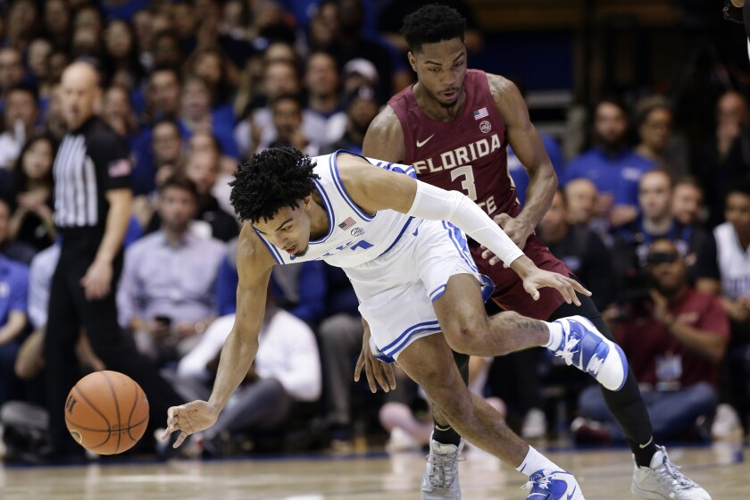 Duke guard Tre Jones, left, chases the ball with Florida State guard Trent Forrest (3) during the first half of an NCAA college basketball game in Durham, N.C., Monday, Feb. 10, 2020. (AP Photo/Gerry Broome)