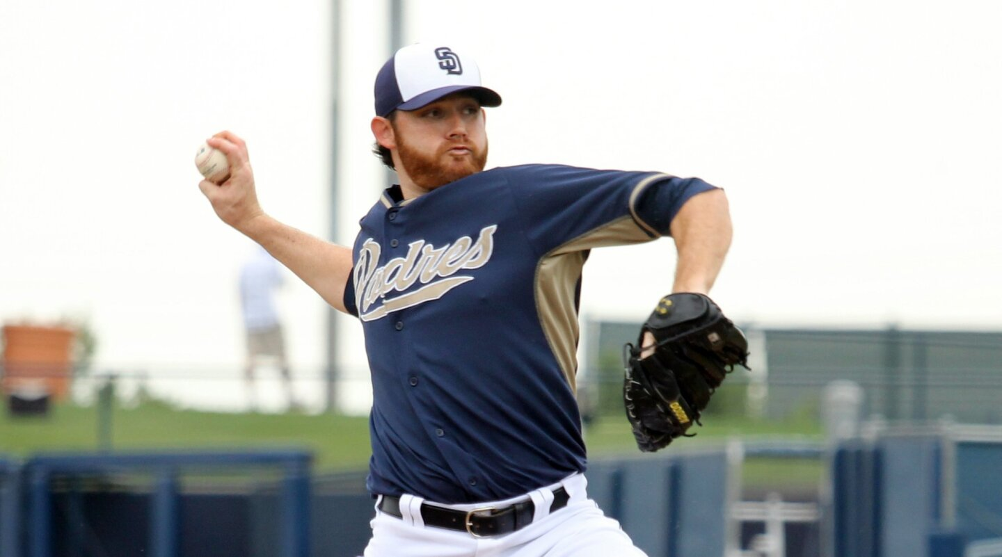 Padres pitcher Ian Kennedy throws against the Rangers during their spring training game in Peoria, Ariz.