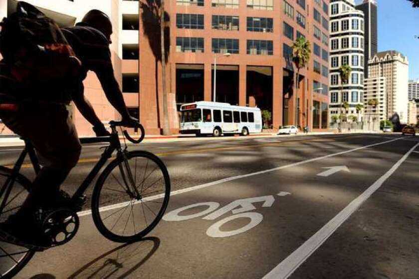 """A cyclist uses the bike lane on 7th Street downtown; the street went on a """"road diet"""" to allow for a bike lane stretching into Koreatown."""