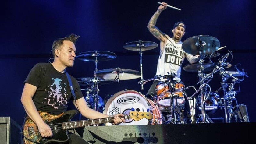 Mark Hoppus (left) and Travis Barker of blink-182 are shown in concert.