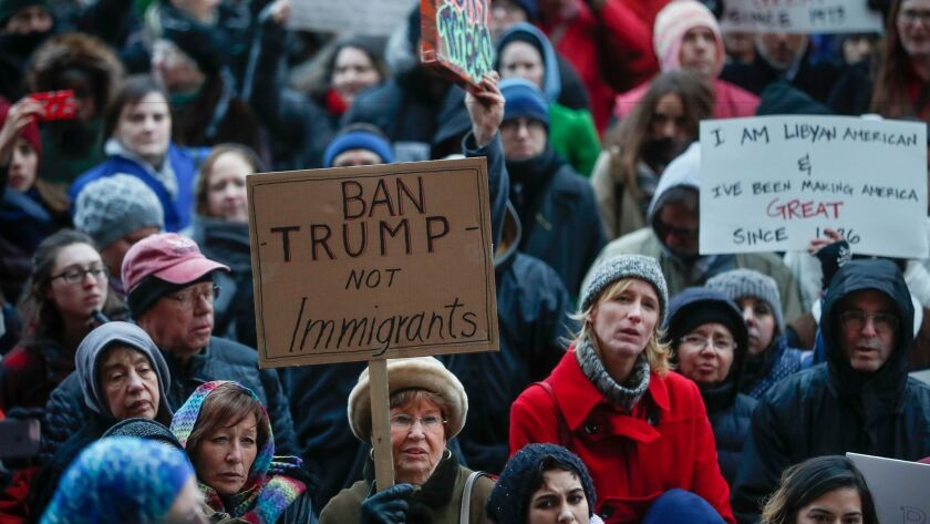 Demonstrators gather in solidarity outside Cincinnati City Hall against President Trump's executive order temporarily banning immigrants from seven Muslim-majority countries from entering the U.S.
