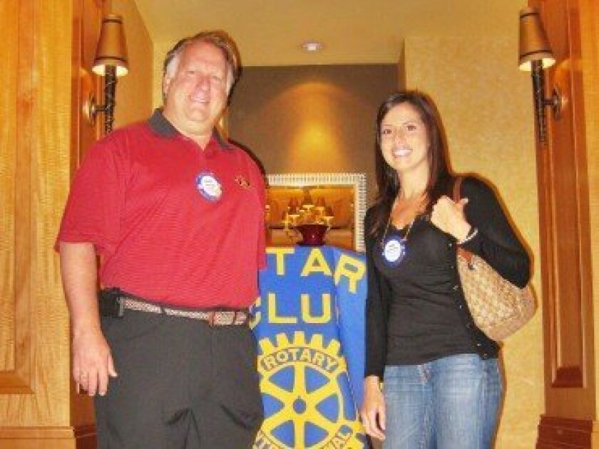 Richard Fogg, president (left), and Radia Bencheikh, Rotarian of the Year (right), of the Del Mar-Solana Beach Rotary Club.