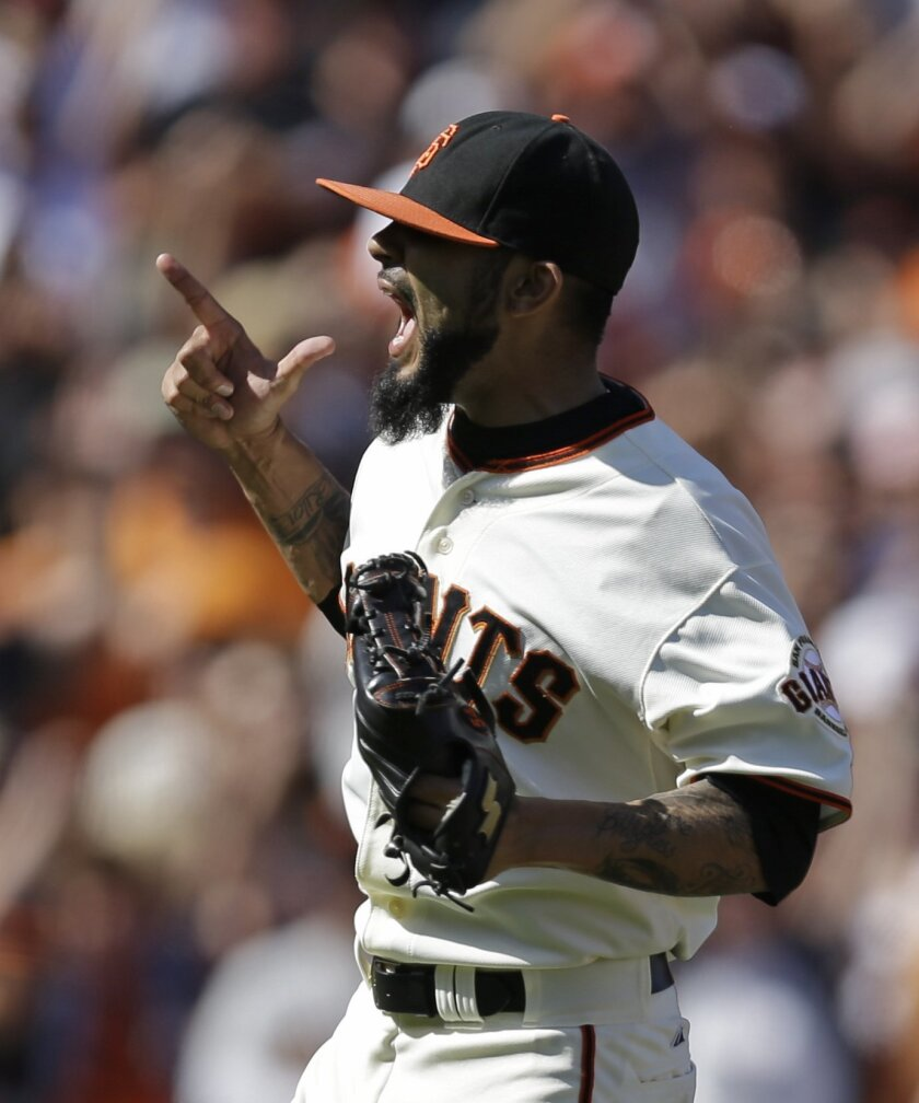 San Francisco Giants' Sergio Romo celebrates after the final out is made against the New York Mets at the end of a baseball game Sunday, June 8, 2014, in San Francisco. The Giants won, 6-4. (AP Photo/Ben Margot)