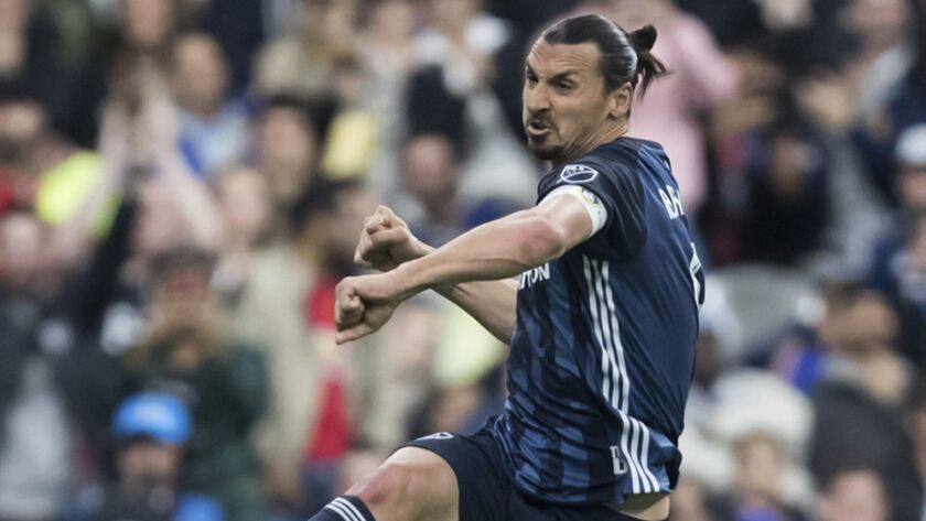 LA Galaxy's Zlatan Ibrahimovic celebrates after scoring a goal against the Vancouver Whitecaps durin
