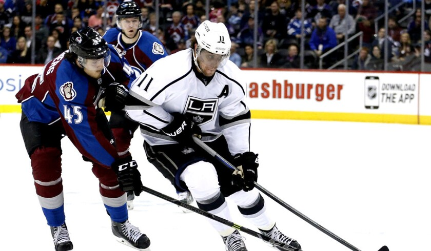 Kings center Anze Kopitar moves the puck against Avalanche right wing Dennis Everberg during the Kings' 5-2 win on Tuesday.