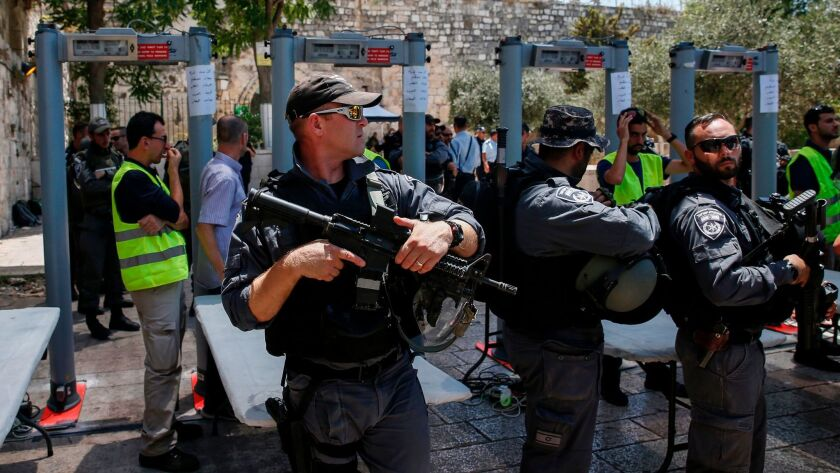Israeli border police stand guard near newly installed metal detectors at the entrance to Al Aqsa compound in Jerusalem's Old City on July 16, 2017.