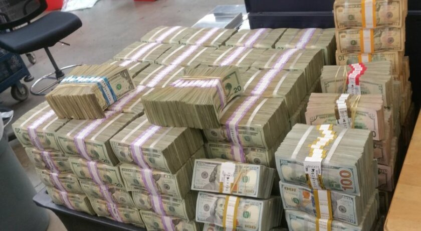 Stacks of cash topping $3 million were seized from two cars in Escondido Tuesday by the U.S. Border Patrol. Two men are alleged to have planned to take the currency to Mexico.