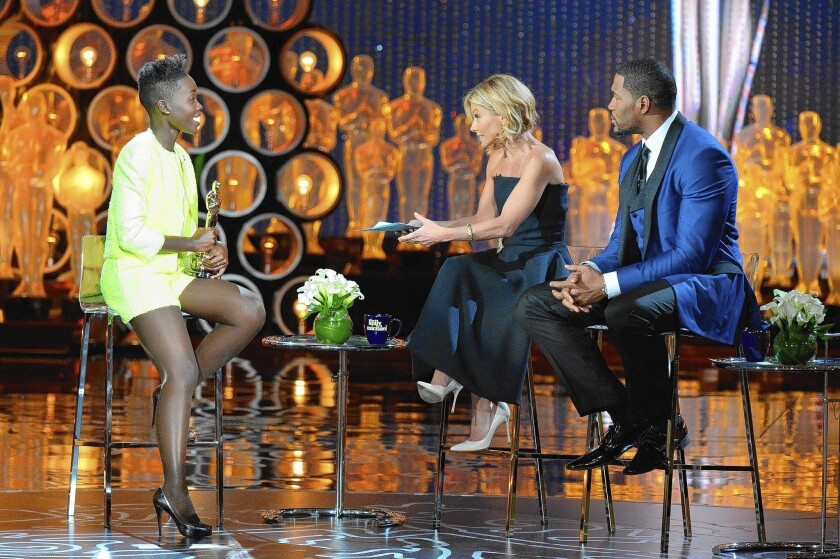 """Oscar winner Lupita Nyong'o, left, got little rest following her big night before going on """"Live"""" with Kelly Ripa and Michael Strahan."""