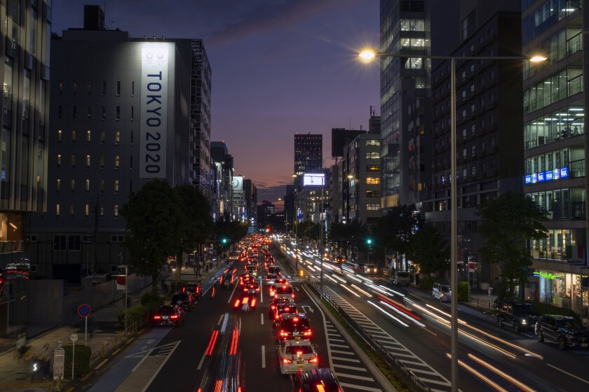 Traffic flows through a business district in Tokyo.