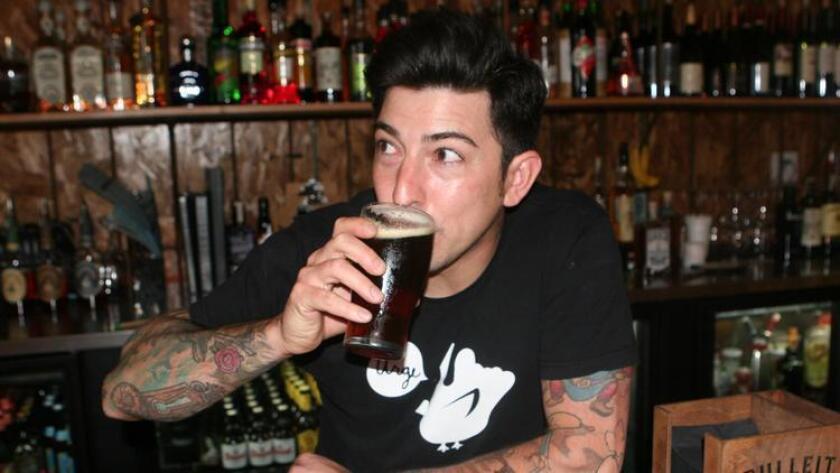 Mason Ale Works brewer, Jason Delatorre, enjoying a Charley Hustle. (Liz Bowen)
