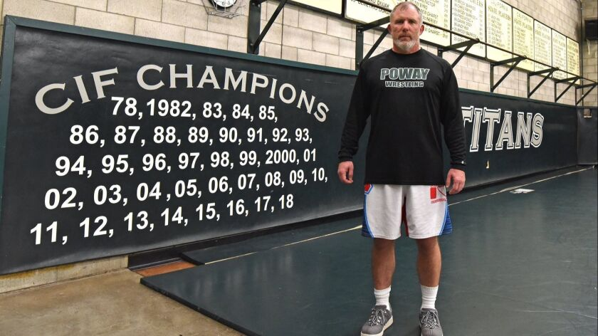 Poway High School wrestling coach John Meyers in the Perry L. Munday Wrestling Center.