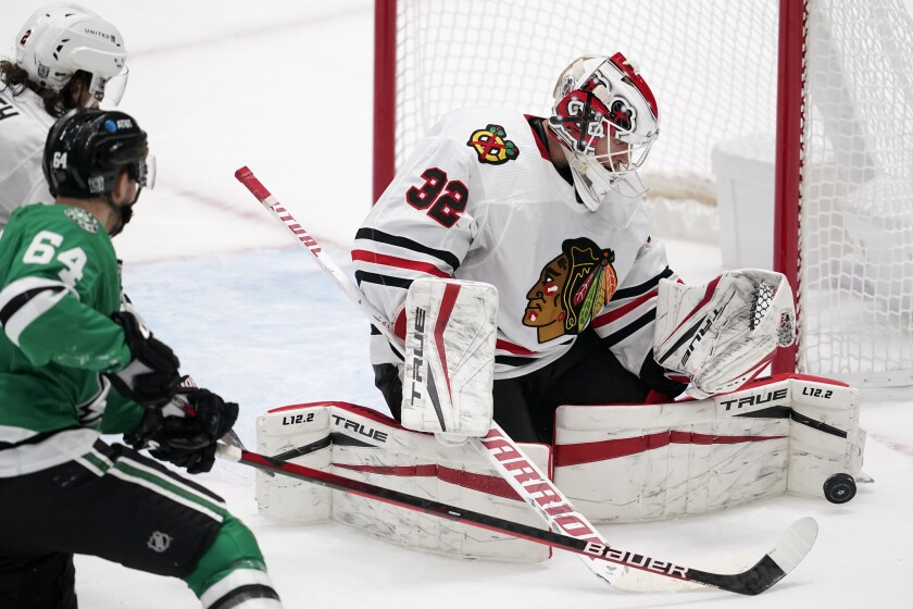 Dallas Stars center Tanner Kero (64) looks on as Chicago Blackhawks' Kevin Lankinen (32) blocks a shot in the second period of an NHL hockey game in Dallas, Tuesday, Feb. 9, 2021. (AP Photo/Tony Gutierrez)