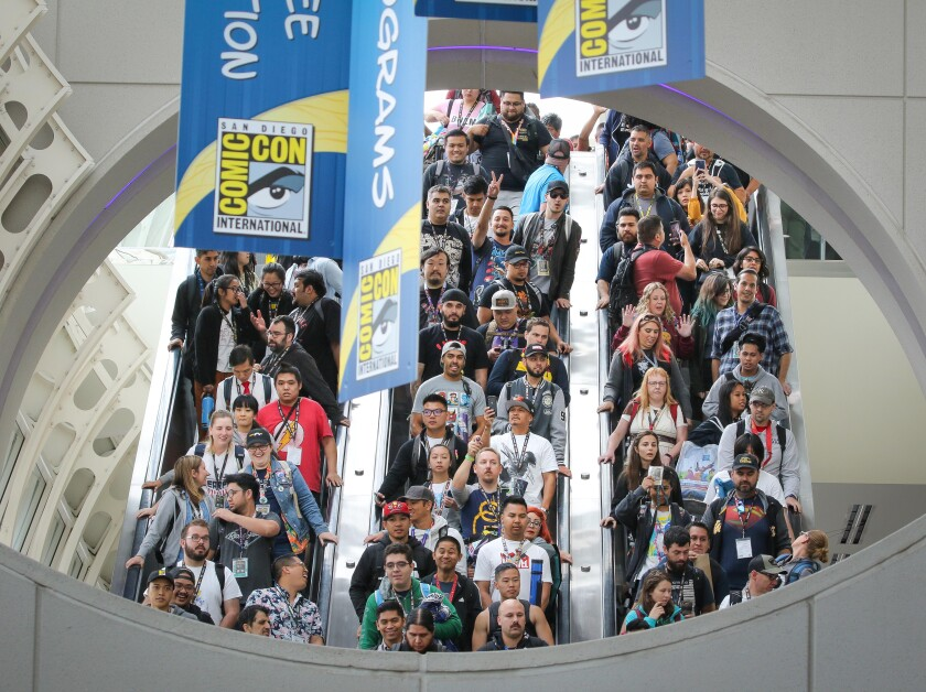 People descend on three packed escalators July 19 at the San Diego Convention Center for Comic-Con.