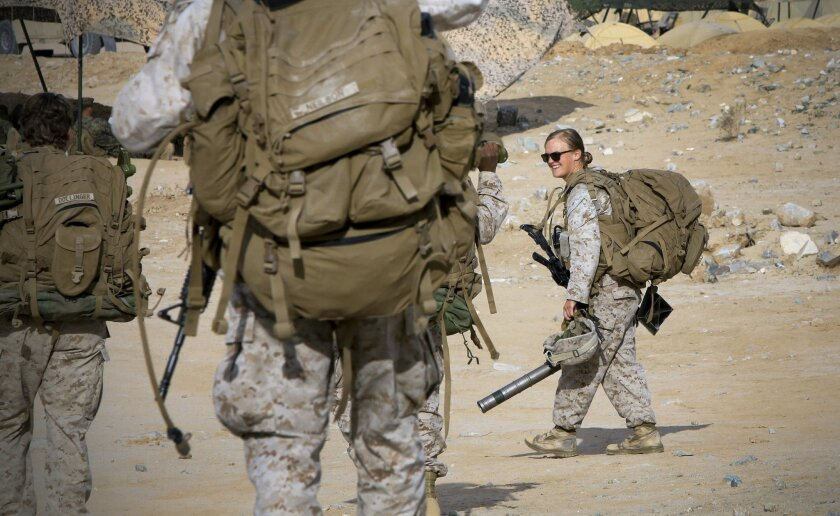 Marines in the Ground Combat Element Integrated Task Force return after a live-fire exercise in March at Twentynine Palms, during the assessment to determine if women should serve in ground combat units.