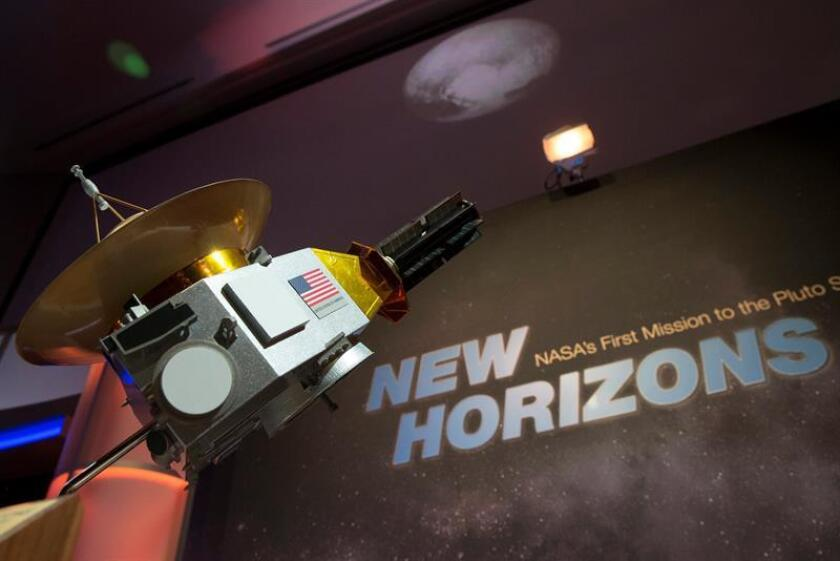 A model of the New Horizons spacecraft is seen at a live television program on NASA television. EFE/EPA/File