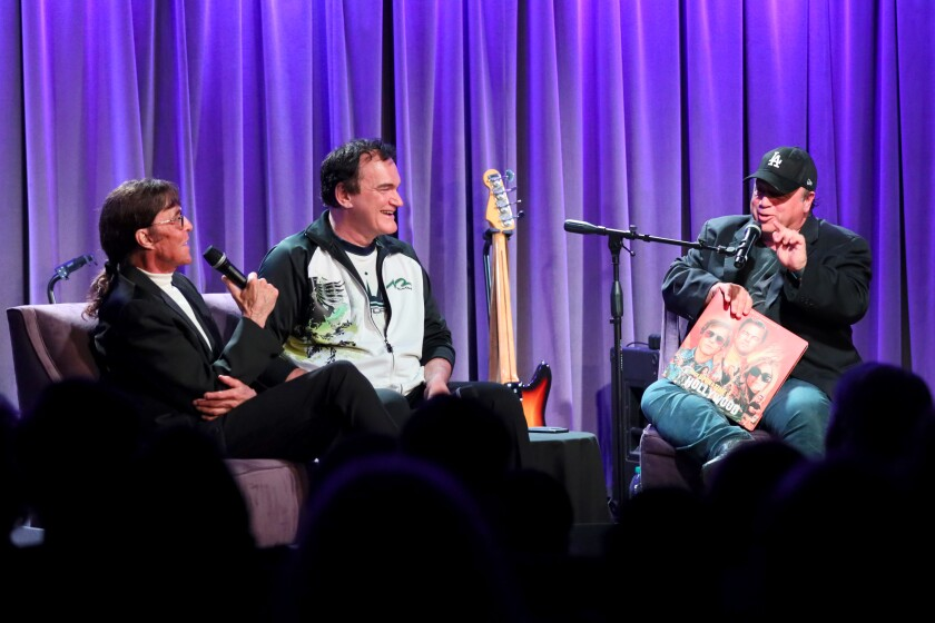 Mark Lindsay of Paul Revere & the Raiders, left, Quentin Tarantino and David Wild in conversation at the Grammy Museum on Wed., Oct. 2.