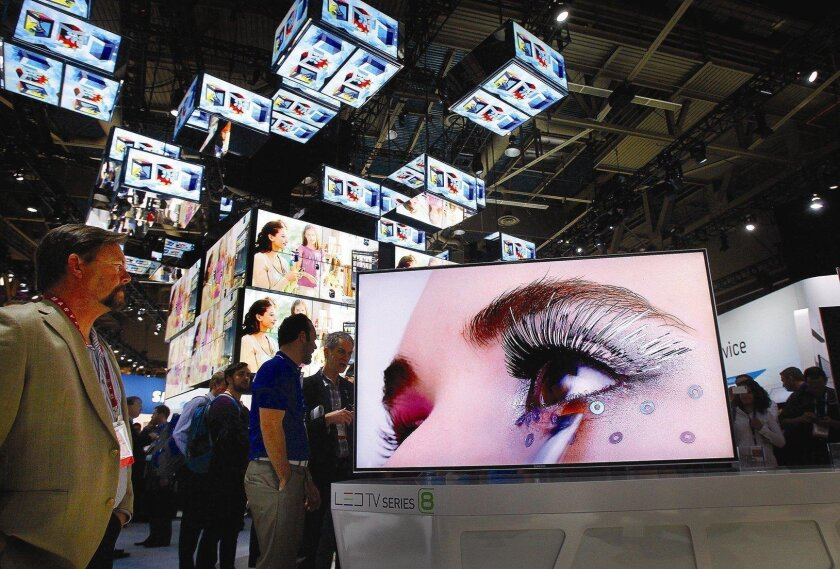 Crowds gather to view the latest in televisions at CES in this 2012 file photo. CES kicks off again on Tuesday, featuring the latest in consumer electronics.