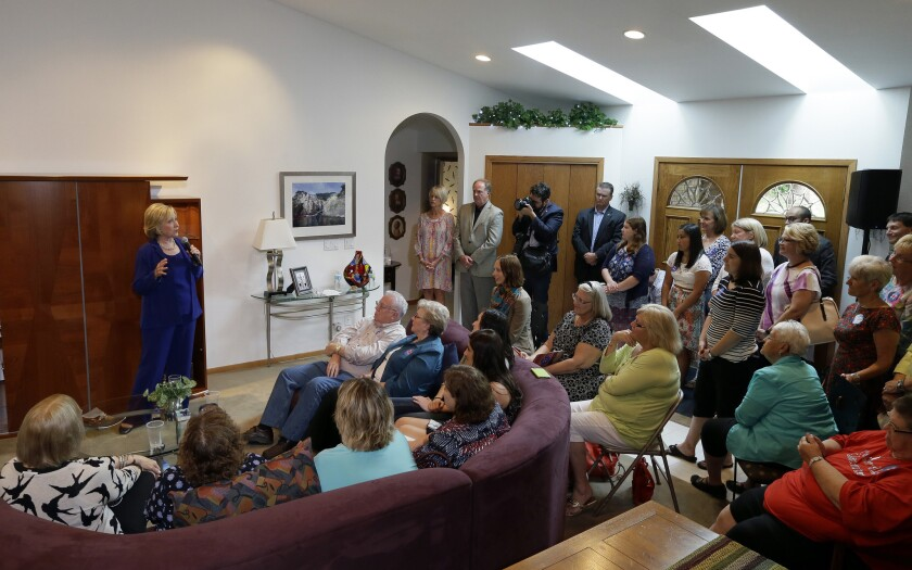 Democratic presidential candidate Hillary Rodham Clinton speaks during a house party in Ottumwa, Iowa. The campaign has used such events to recruit volunteers and collect email addresses and other information about supporters.